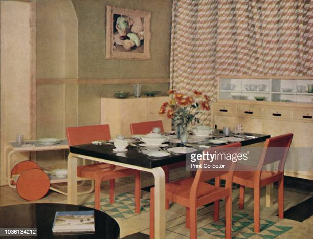 Dining Room with Finnish furniture'' 1938 Arranged by Finmar Ltd furniture designed by Alvar Aalto made of cellulosed birch Table legs and trolley...