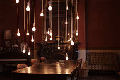 Dining room with hanging lightbulbs