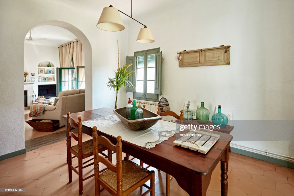 Dining Room With View Into Living Room In Spanish Home High Res Stock Photo Getty Images