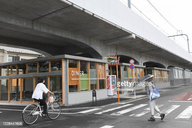 Dining space for university students sit under railway tracks in Tokyo, Japan, on Thursday, Sept. 3, 2020. In Tokyo, the spaces beneath elevated...