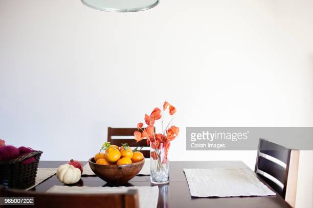 dining table by wall at home - dining room stock pictures, royalty-free photos & images