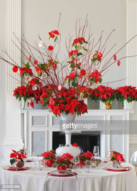 Dining table decorated with poinsettias