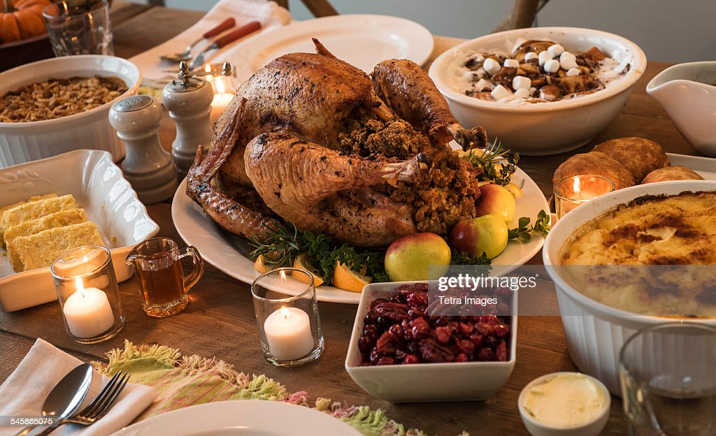 Dining Table Filled With Thanksgiving Food Stock Photo
