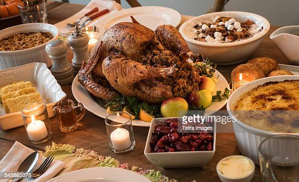 dining table filled with thanksgiving food - banquet stock pictures, royalty-free photos & images