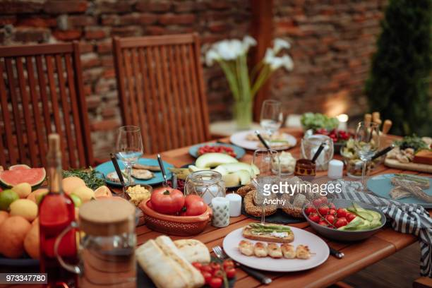 dining table food outdoors concept - ready to eat stock pictures, royalty-free photos & images