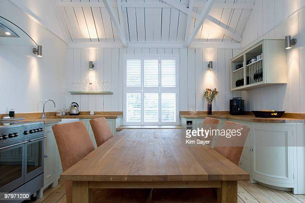 dining table in domestic kitchen - dining room stock pictures, royalty-free photos & images