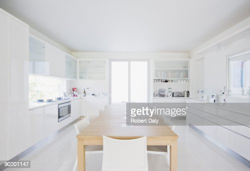 dining table in modern white kitchen stock photo getty images