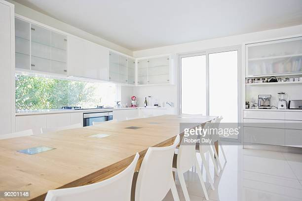 dining table in modern, white kitchen - dining room stock pictures, royalty-free photos & images