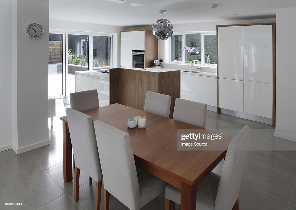 Dining table in open plan house : Stock Photo