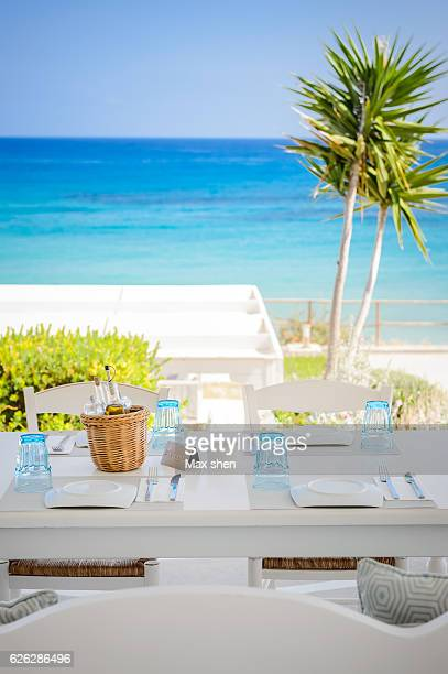 Dining table in the sea view restaurant at the Heraklion beach in Crete island