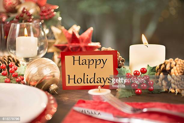 Dining table place setting with Christmas decorations.