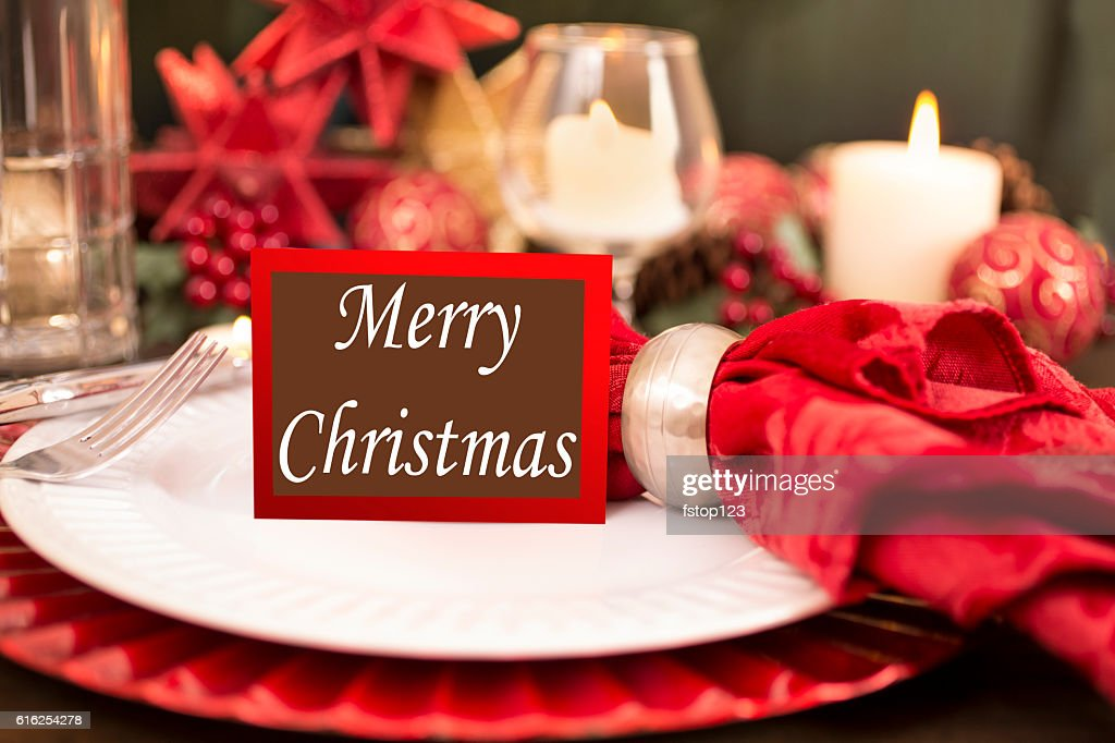 Dining table place setting with Merry Christmas holiday decorations. : Foto de stock