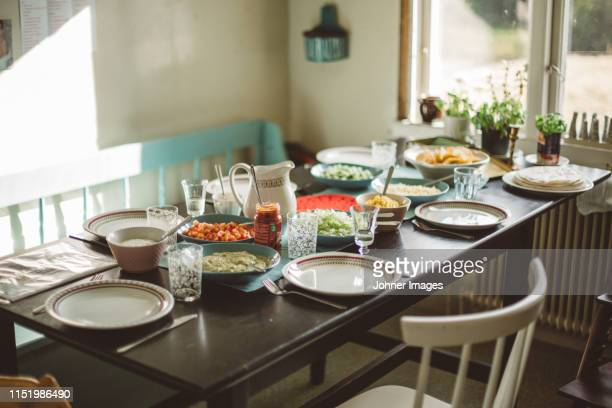 dining table prepared for lunch - dining room stock pictures, royalty-free photos & images
