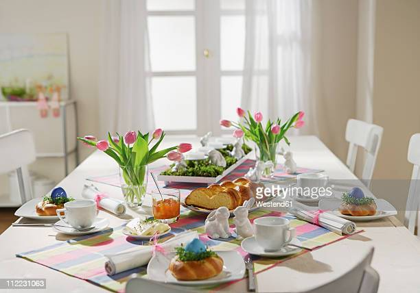 dining table with easter breakfast setting - easter stock pictures, royalty-free photos & images