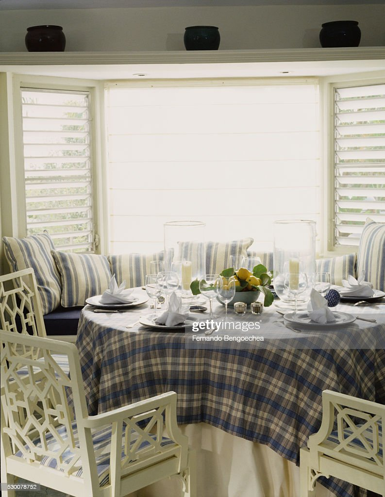 Dining Table With Window Seating In Bay Stock Photo