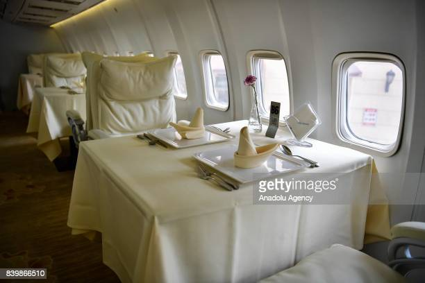 Dining tables are seen inside of a Boeing 737 which is used for a restaurant at Guanggu Walking Street in Wuhan of Hubei Province China on August 27...