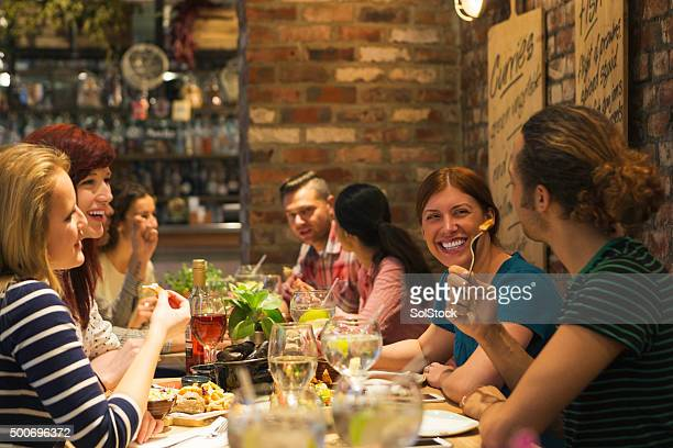 dining with friends - restaurant stock photos and pictures