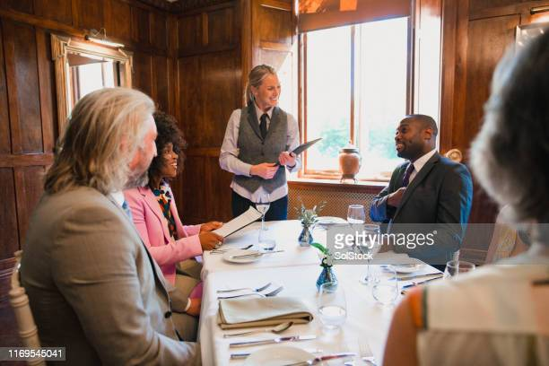 dining with my colleagues - expense stock pictures, royalty-free photos & images