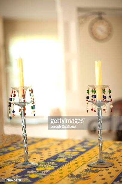 diningroom table with two candles - joseph squillante stock pictures, royalty-free photos & images