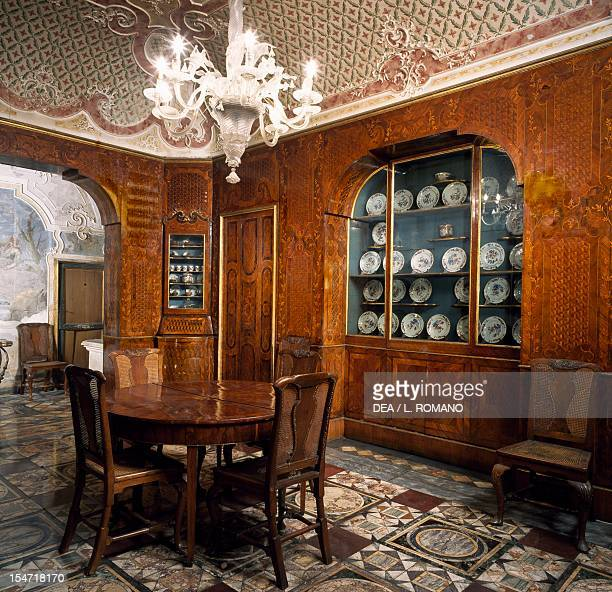 Diningroom walls covered with decorative wooden panel Palazzo Biscari Catania Sicily Italy 18th century