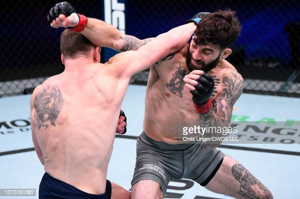 Dinis Paiva punches Kyle Driscoll in their featherweight bout during week seven of Dana White's Contender Series season four at UFC APEX on September...
