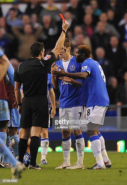Diniyar Bilyaletdinov of Everton is sent off during the Barclays Premier League match between Everton and Aston Villa at Goodison Park on October 31...