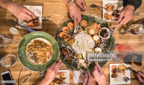 Dinner guests at Bistro 1521 a Filopino restaurant enjoy Canton egg noodles shrimp carrots green beans and cabbage and IhawIhaw Special shrimp jumbo...