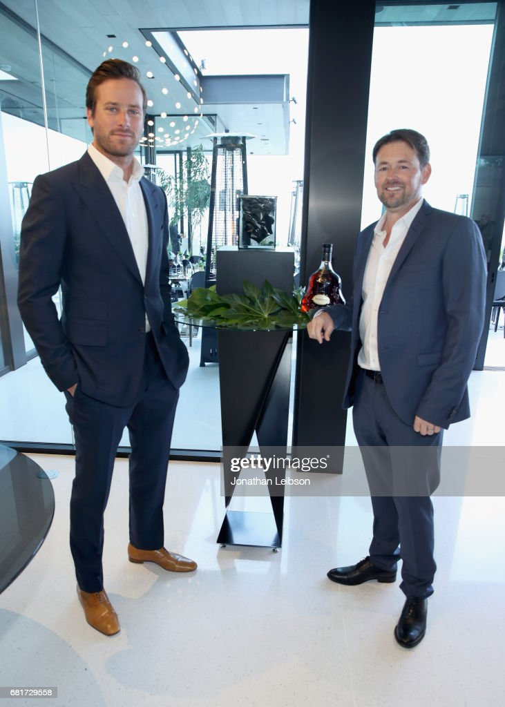 Dinner host and actor Armie Hammer (L) and architect Paul McClean pose by Paul's newly designed Hennessy X.O ice bucket during a private dinner in Beverly Hills, CA on May 10, 2017. The 3-D printed ice bucket encourages serving Hennessy X.O, the world's original Extra Old Cognac, on ice to best enjoy the spirit's multisensory taste odyssey.