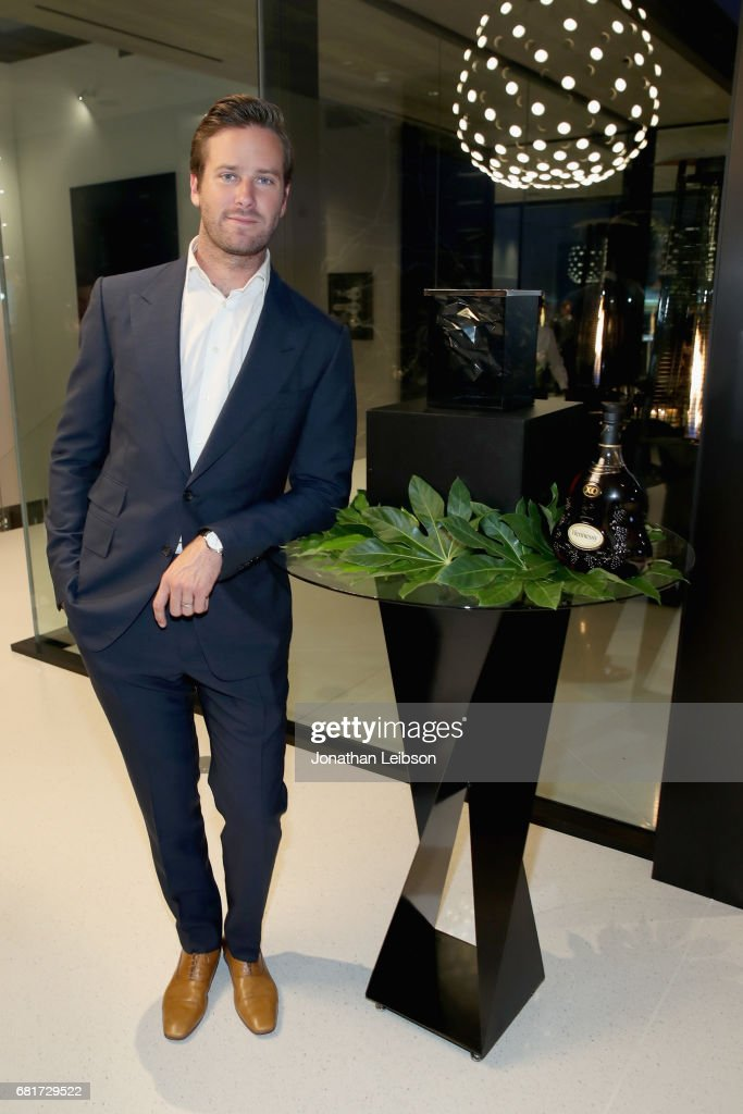Dinner host and actor Armie Hammer poses by Paul's newly designed Hennessy X.O ice bucket during a private dinner in Beverly Hills, CA on May 10, 2017. The 3-D printed ice bucket encourages serving Hennessy X.O, the world's original Extra Old Cognac, on ice to best enjoy the spirit's multisensory taste odyssey.
