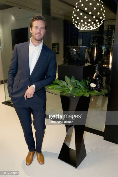 Dinner host and actor Armie Hammer poses by Paul's newly designed Hennessy XO ice bucket during a private dinner in Beverly Hills CA on May 10 2017...