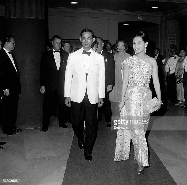 Dinner in Honor of Thailand's King and Queen New York New York Wearing a sheath dress of turquoise and gold embroidered silk Thailand's Queen Sirikit...