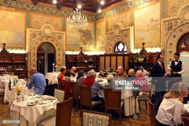 Dinner is served in the opulent restaurant dining room of the Bussaco Palace hotel on October 4 2016 near Luso in central Portugal The hotel...
