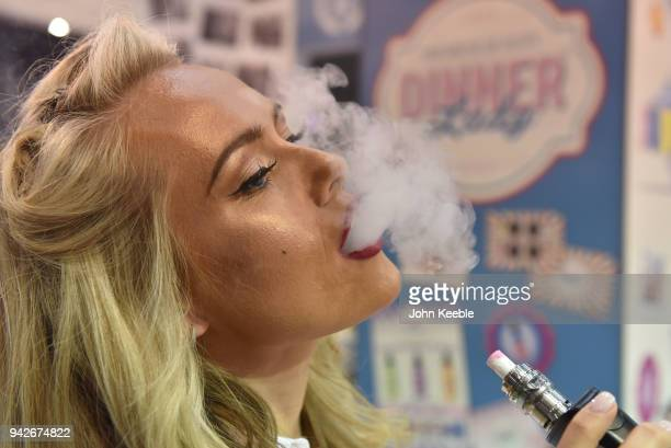 Dinner Lady promotional girl vapes during the Vape Jam UK 4 at ExCel on April 6 2018 in London England Vape Jam UK the premier Electronic Cigarette...