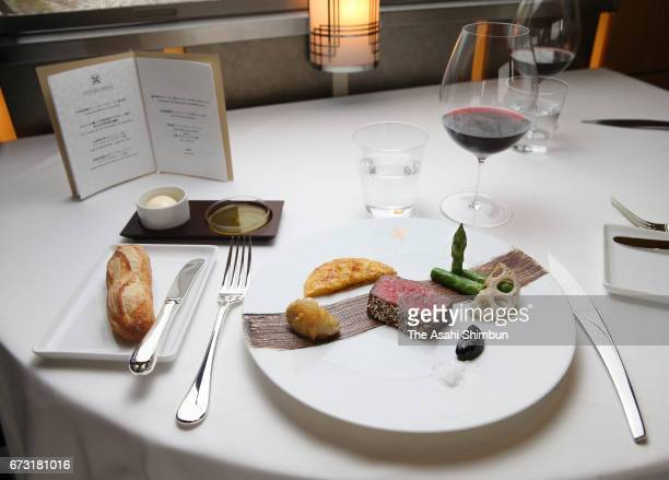 A dinner offered at the Dining of the JR East's 'Train Suite ShikiShima' is seen during the press preview on April 26 2017 in Tokyo Japan The luxury...