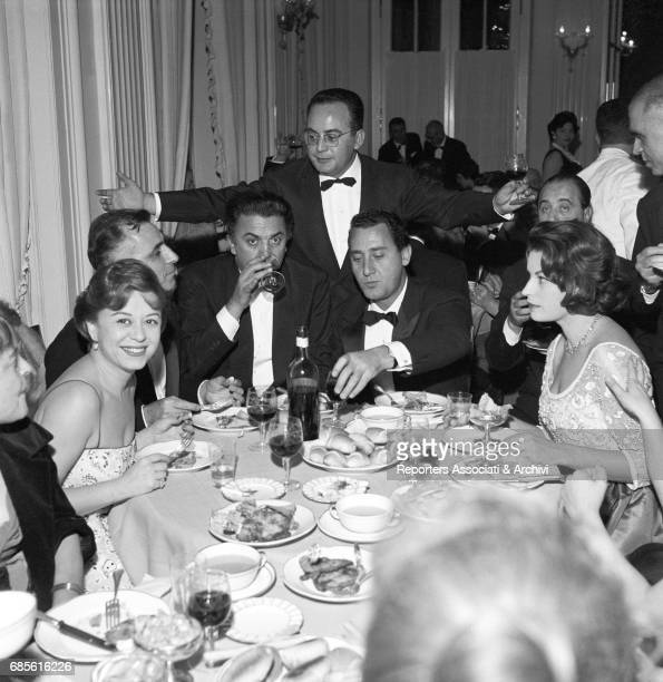 Dinner party for the premiere of The Tempest directed by Alberto Lattuada at Teatro San Carlo in Naples Among the guests Giulietta Masina Federico...