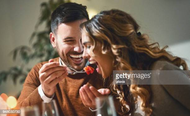 dinner party. - flirting stock pictures, royalty-free photos & images