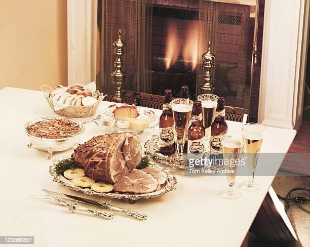 Dinner set on table beside fireplace