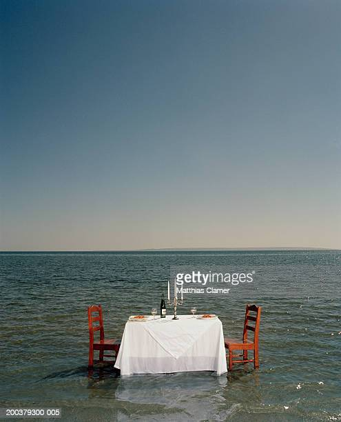 Dinner table in middle ocean, side view