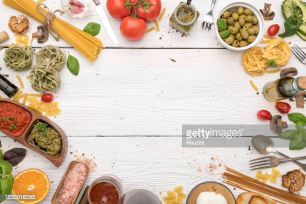 dinner table. italian food and ingredients with copy space - italian culture stock pictures, royalty-free photos & images