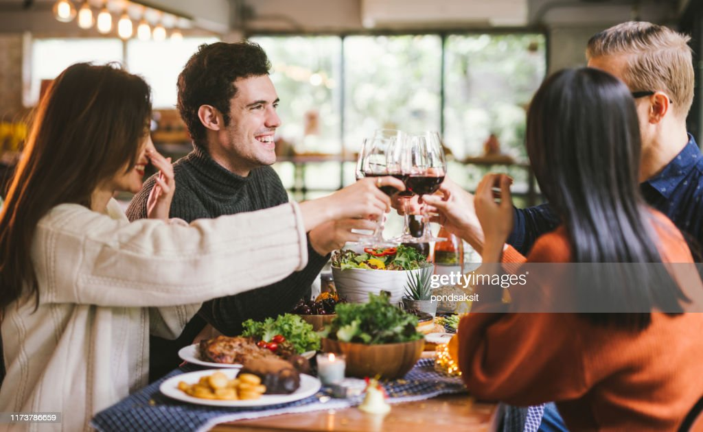 Dinner with friends. Group of young people enjoying dinner together. Dining Wine Cheers Party thanksgiving Concept : Stock Photo