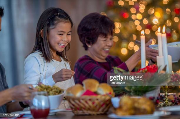 dinner with grandma - filipino family dinner stock pictures, royalty-free photos & images