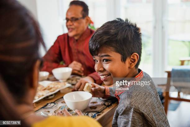 dinner with his family - western europe stock pictures, royalty-free photos & images