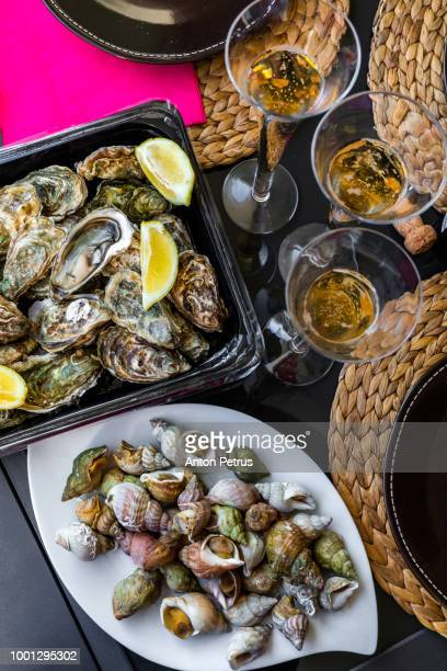 Dinner with seafood - oysters, prawns, shellfish and champagne