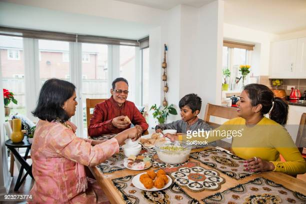 dinner with the family - eid ul fitr stock pictures, royalty-free photos & images