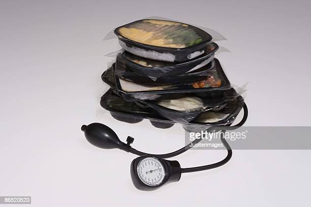 TV dinners on a blood pressure cuff and monitor