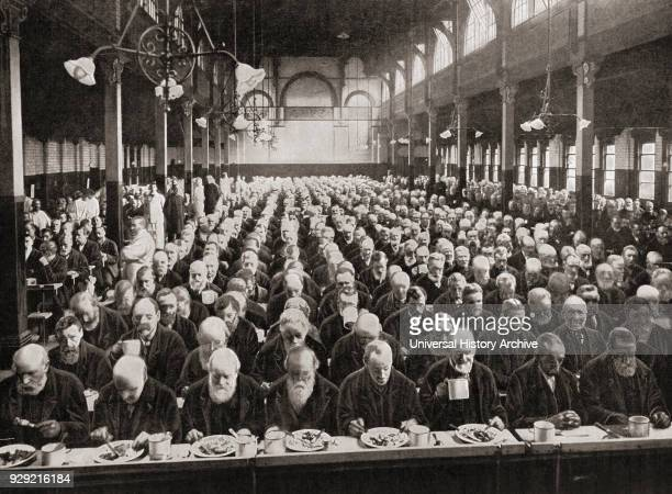 Dinnertime for the inmates of a workhouse London England in the late 19th century Workhouses were places where those unable to support themselves...