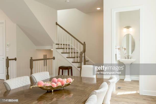 Dinng area Staircase and Powder Room in the Vivian Model Home at The Village at Arundel Mills on April 19 2019 in Hanover Maryland