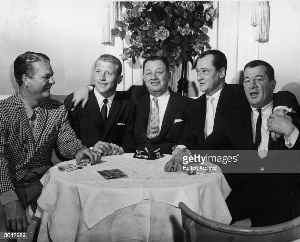 Dinning at the Harwyn Club New York New York late 1950s Golfer Jimmy Demeret baseball player Mickey Mantle restaurant and bar owner Bernard Toots...