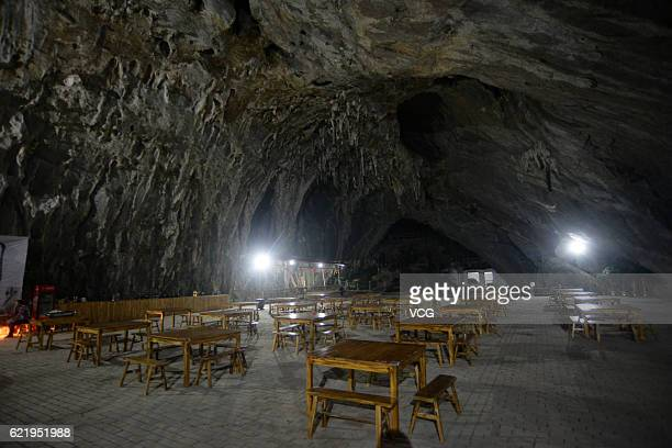 Dinning tables are set in a cave restaurant on November 8 2016 in Chenzhou Hunan Province of China The cave restaurant in Chenzhou could hold about...