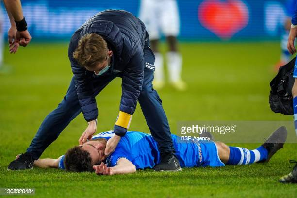Dino Arslanagic of KAA Gent injured during the Jupiler Pro League match between KAA Gent and Cercle Brugge at Ghelamco Arena on March 21, 2021 in...